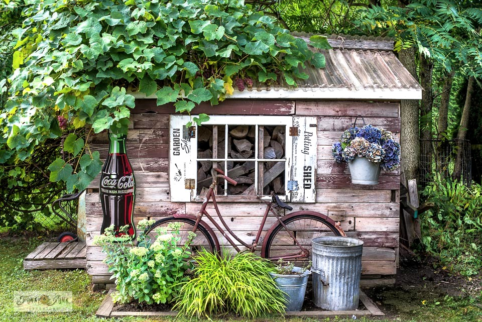 Learn how to decorate a rustic garden shed with reclaimed wood and antiques! #gardenshed #pottingshed