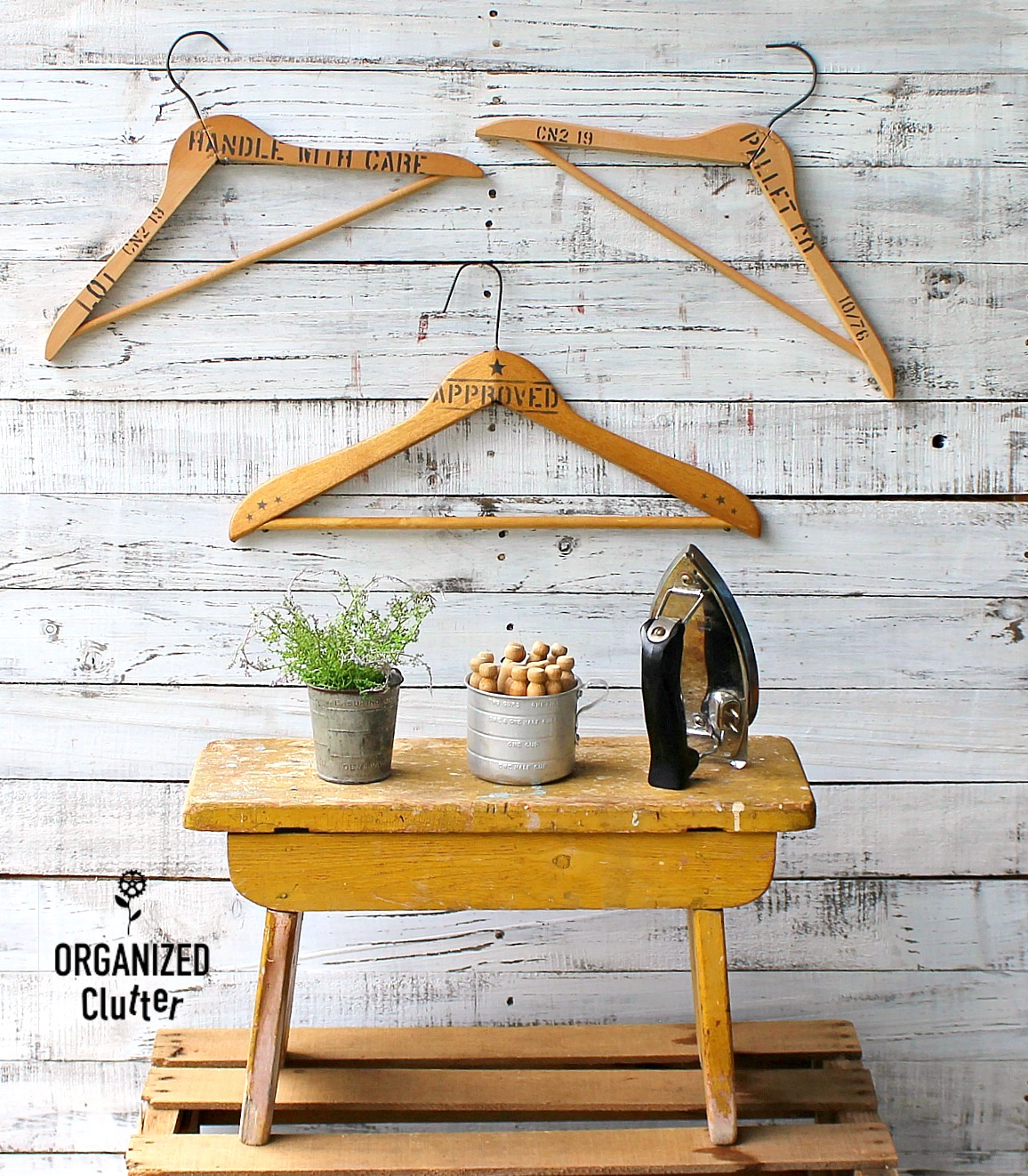 Crate stenciled vintage wooden laundry hangers by Organized Clutter, featured on Funky Junk Interiors
