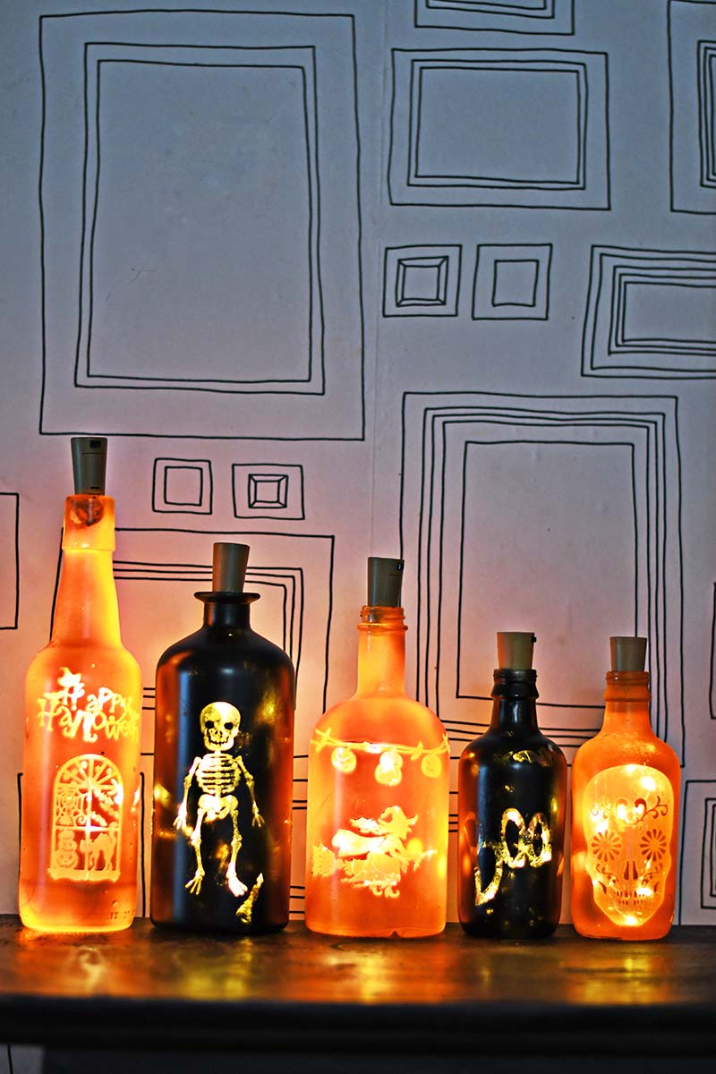 Illuminated Halloween bottles by Pillar Box Blue, featured on Funky Junk Interiors
