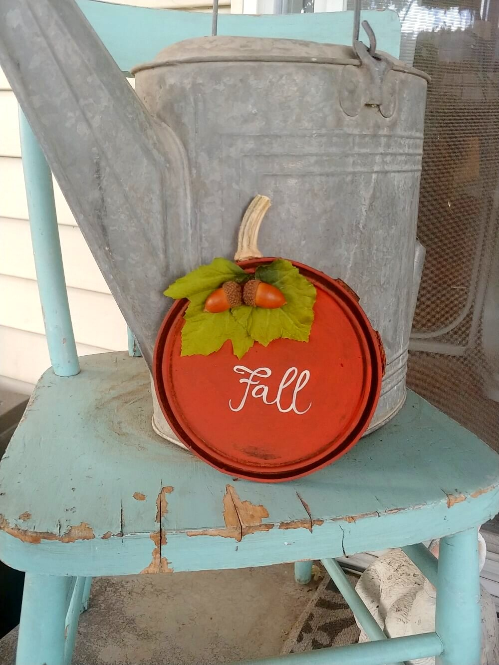 Rusty paint can lid pumpkins by Little Vintage Cottage, featured on Funky Junk Interiors