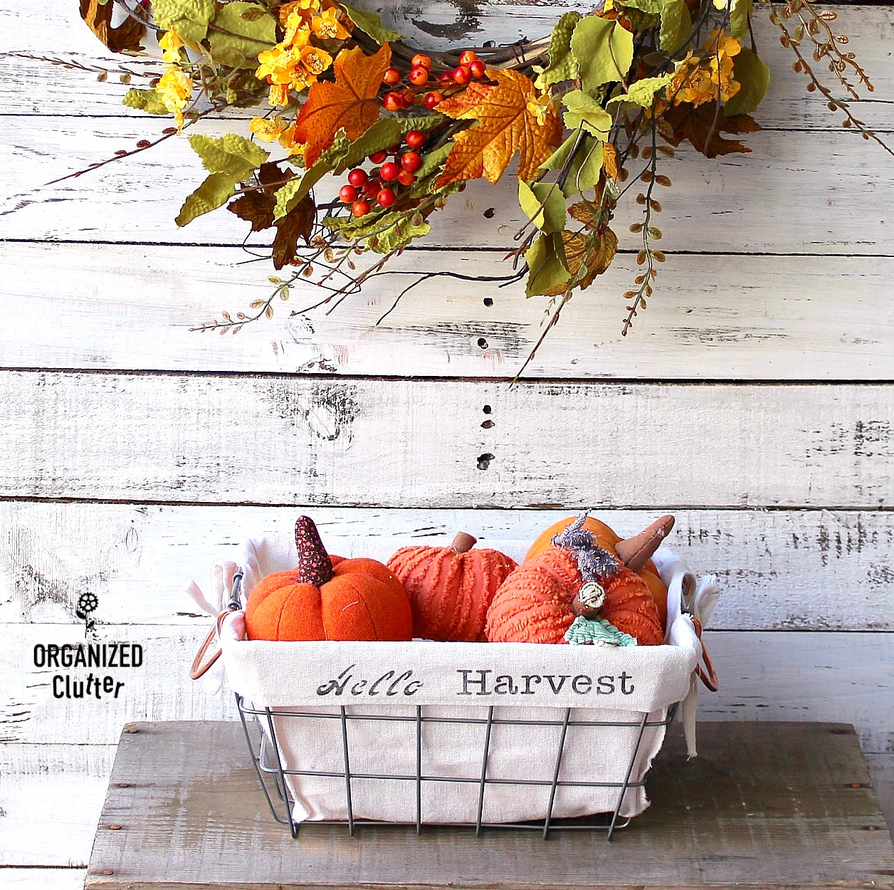 Stenciled fall dollar store baskets by Organized Clutter, featured on Funky Junk Interiors