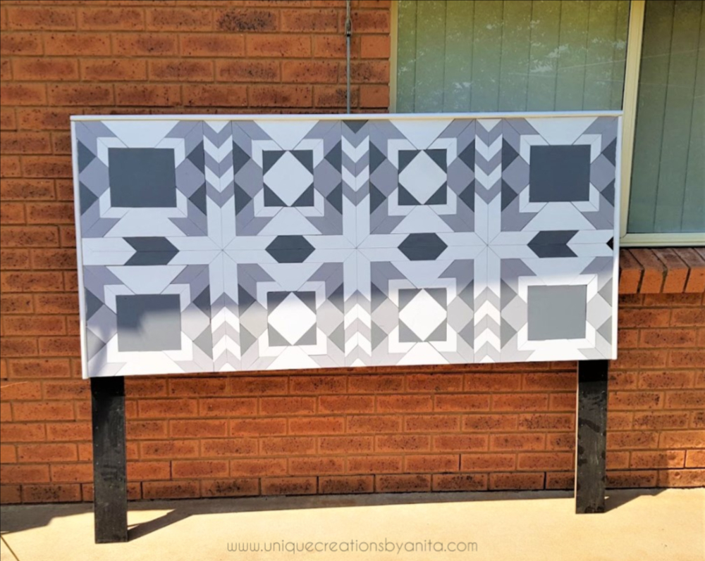 Wooden barn quilt headboard by Unique Creations By Anita, featured on Funky Junk Interiors