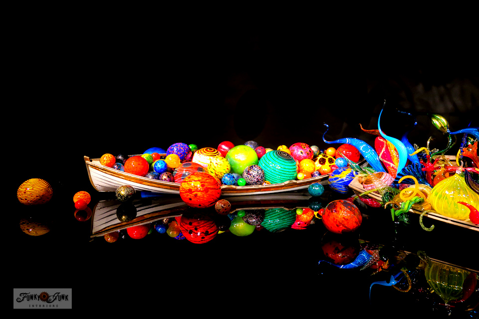 View the full sized boats holding the incredible and vibrant blown glass sculptures at Chihuly Garden and Glass, in Seattle Washington.