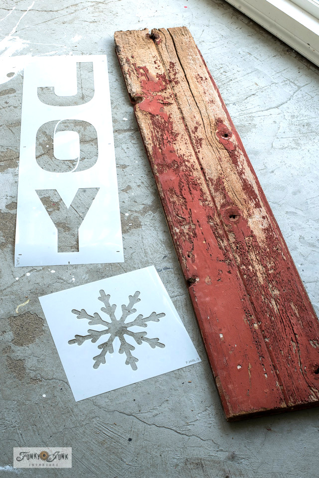 Learn how to make this super festive rustic JOY Christmas porch sign in minutes with stencils, including a snowflake replacing the O! With Funky Junk's Old Sign Stencils