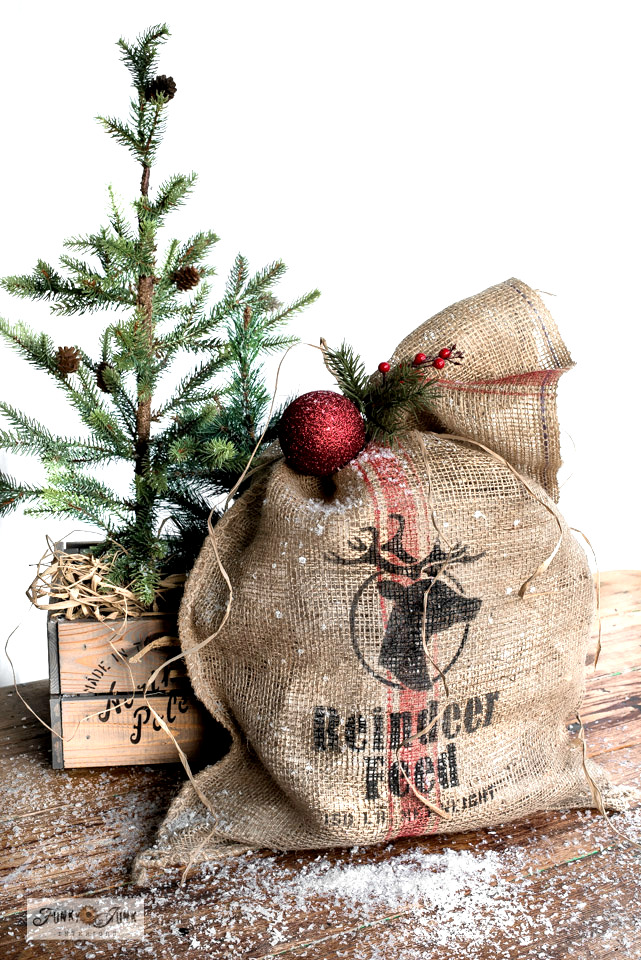 Learn how to make this rustic Christmas Reindeer Feed Santa Sack from a burlap sandbag! Complete with a vintage grain sack stripe for an authentic look! Featuring Funky Junk's Old Sign Stencils and Fusion Mineral Paint.