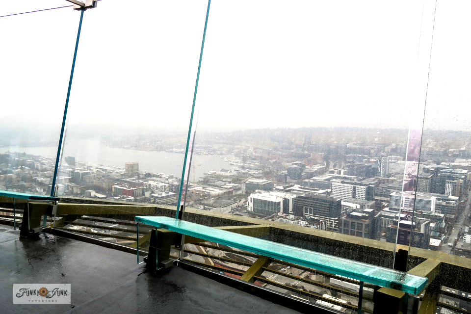Take a tour of the top viewing observation deck of the Space Needle during low season. No people! Amazing unobstructed floor to ceiling views of the city.