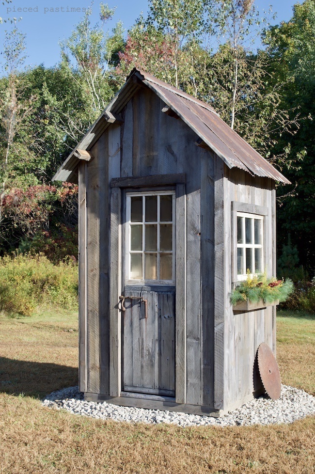 Rustic shed electric panel cover by Pieced Pastimes, featured on Funky Junk Interiors