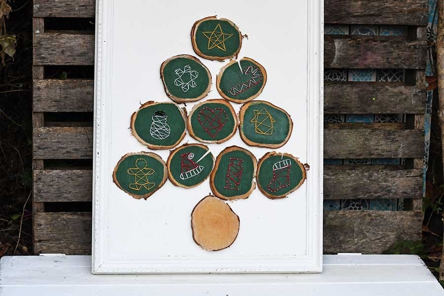 Wood slice string art Christmas tree by Pillar Box Blue, featured on Funky Junk Interiors