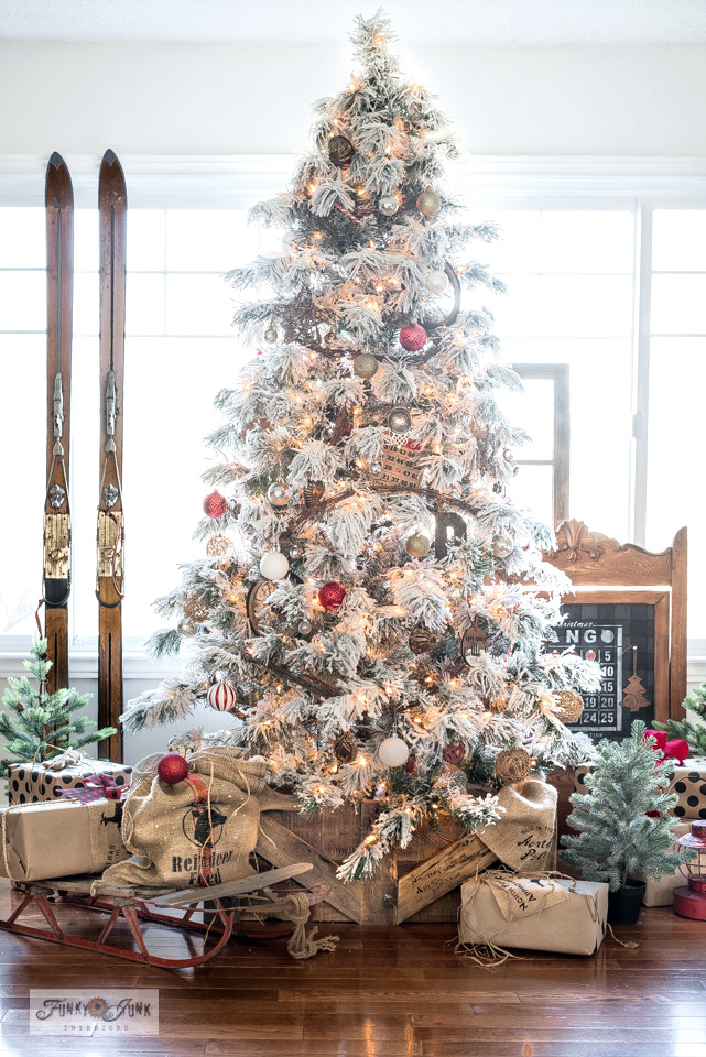 Take the Christmas living room tour of this flocked Christmas tree with DIY tree crate skirt, vintage skis, vintage sleigh, Reindeer Feed Santa Sack, Christmas Bingo Countdown, screened windows, plus!