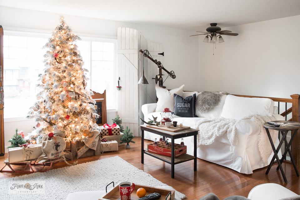 Take the Christmas living room tour of this flocked Christmas tree with DIY tree crate skirt, white slipcovered Ikea Ektorp 3.5 sofas, Sugar grain sack pillow, plus!