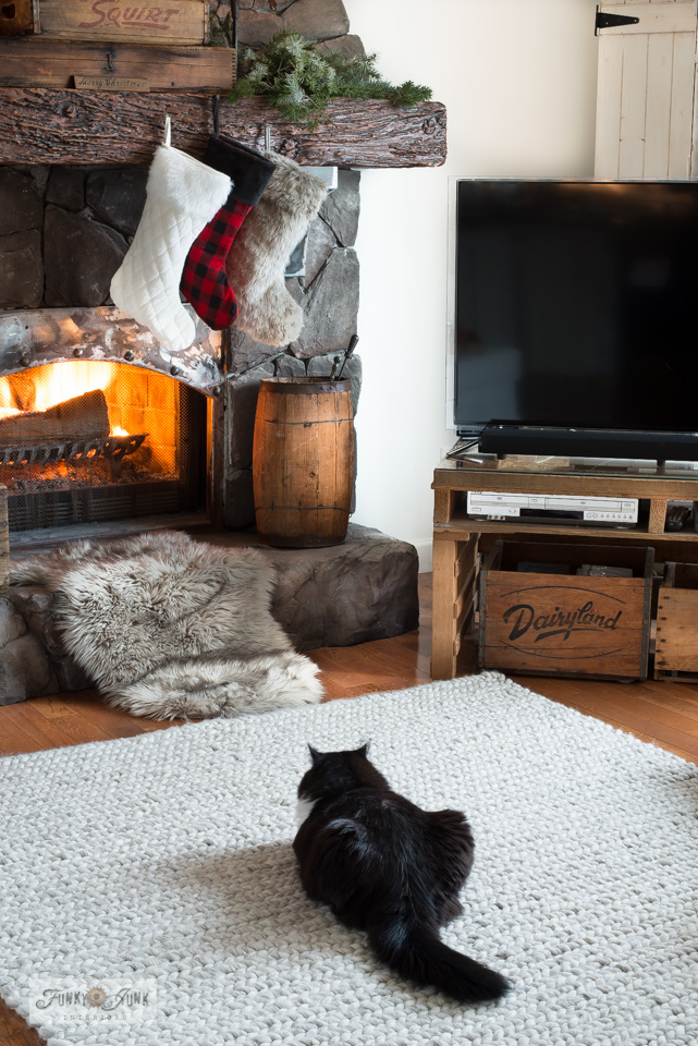 Take this Christmas living room tour including a thick looped Ikea carpet, fur and buffalo checked stockings, a rock fireplace, plus!