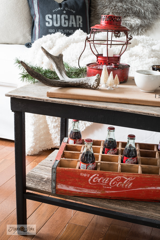 Take this Christmas living room tour with a white slipcovered Ektorp 3.5, grain sack sugar pillow, vintage coke and crate, rustic black metal and wood coffee table, cutting board top, vintage red train lantern, plus!