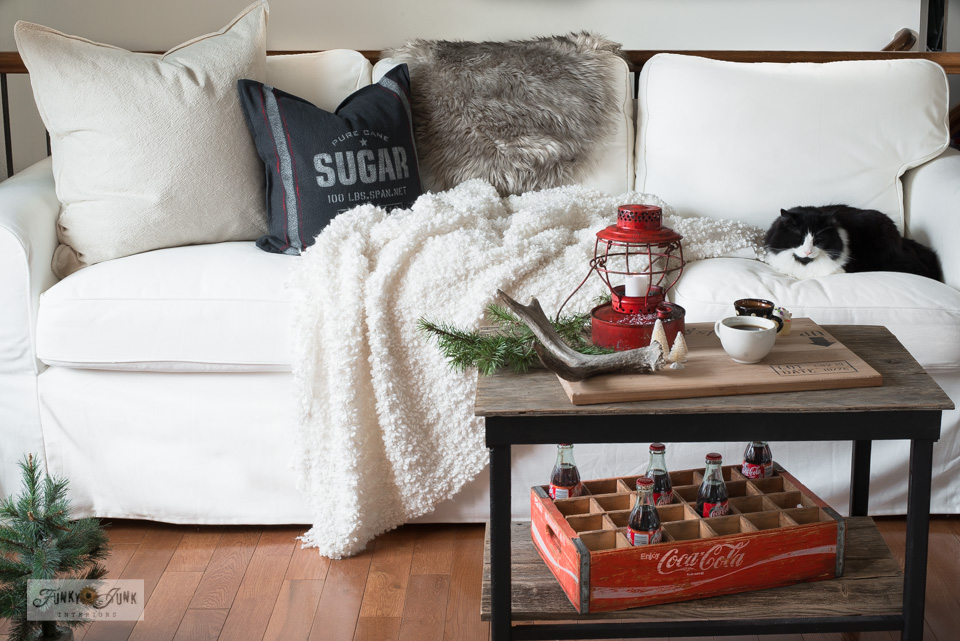 Take this Christmas living room tour with a white slipcovered Ektorp 3.5, grain sack sugar pillow, vintage coke and crate, sleeping black and white cat, plus!
