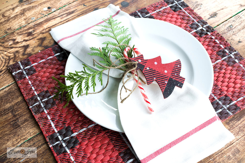 Stencil Buffalo Checked placemats for Christmas decorating! / Learn how to create rustic Christmas decorating ideas with reclaimed wood and stencils! Featuring Funky Junk's Old Sign Stencils. Click to view many ideas all leading to full tutorials with helpful videos! #christmas #stencils #reclaimedwood