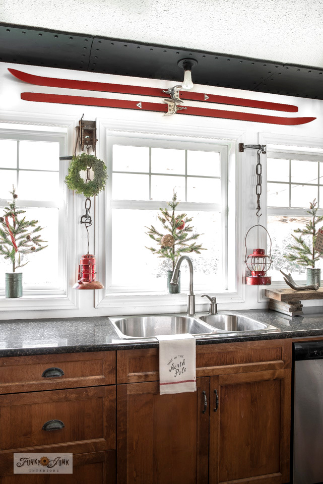 Take this Christmas junk kitchen and living room home tour which includes a red skis kitchen valance, antique red train lanterns, tin canned Hobby Lobby Christmas trees, plus!