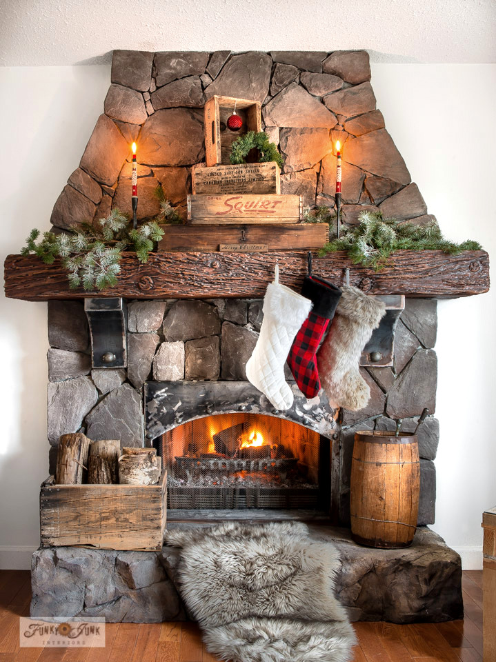 Take the tour of this Christmas vintage crates rock fireplace mantel in a living room, part of a Christmas junk home tour.