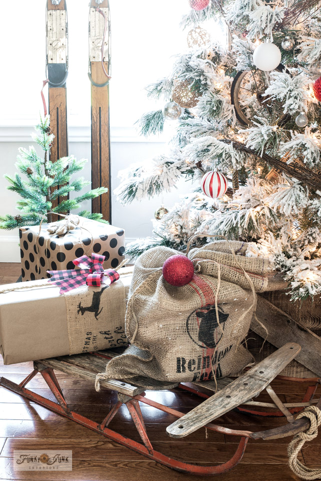 Learn how to make a Reindeer Feed santa sack from a burlap sandbag, and custom wrap presents using stencils on the ribbon and paper with Funky Junk's Old Sign Stencils!