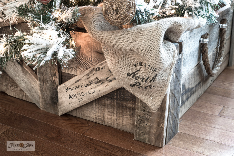 Learn how to make this easy DIY reclaimed wood Christmas tree crate skirt from pallet wood, burlap sand bags and ropes. Very rustic farmhouse!