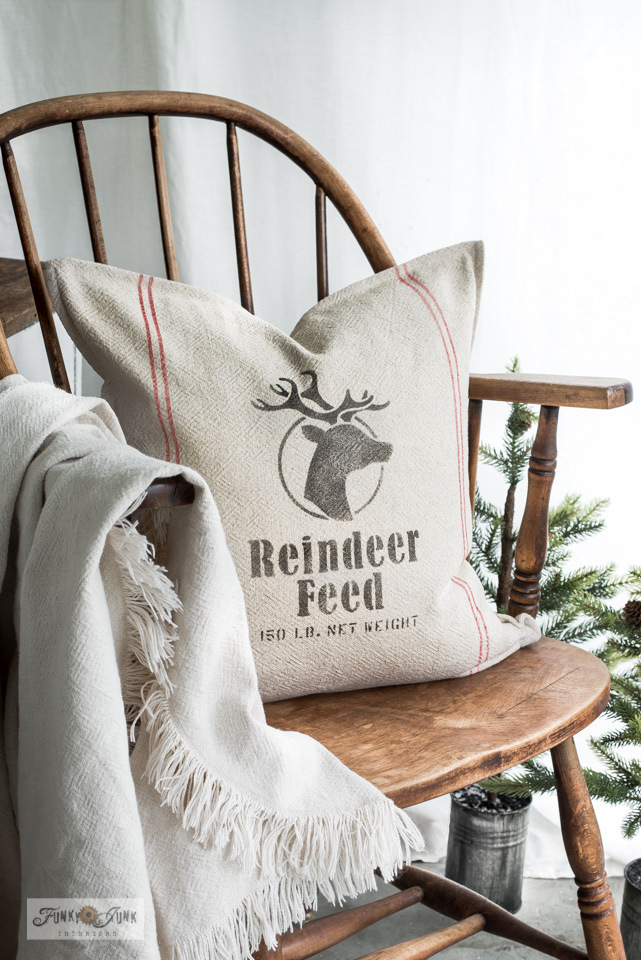 Stencil a grain sack striped Reindeer Feed pillow for Chrsitmas! / Learn how to create rustic Christmas decorating ideas with reclaimed wood and stencils! Featuring Funky Junk's Old Sign Stencils. Click to view many ideas all leading to full tutorials with helpful videos! #christmas #stencils #reclaimedwood