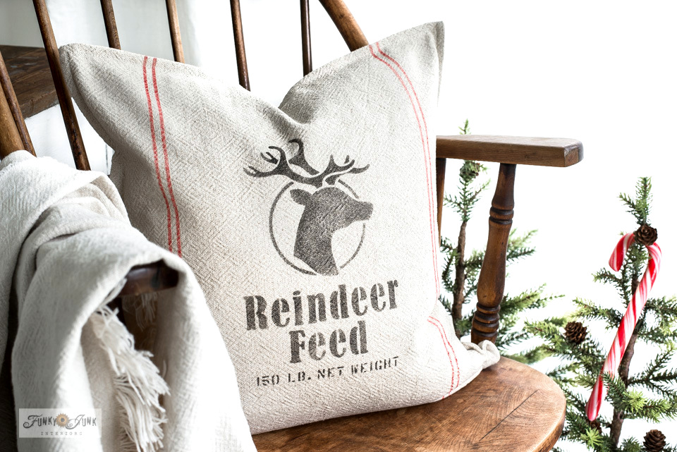 Learn how to stencil this grain sack striped Reindeer Pillow with Ikea pillow covers and stencils!