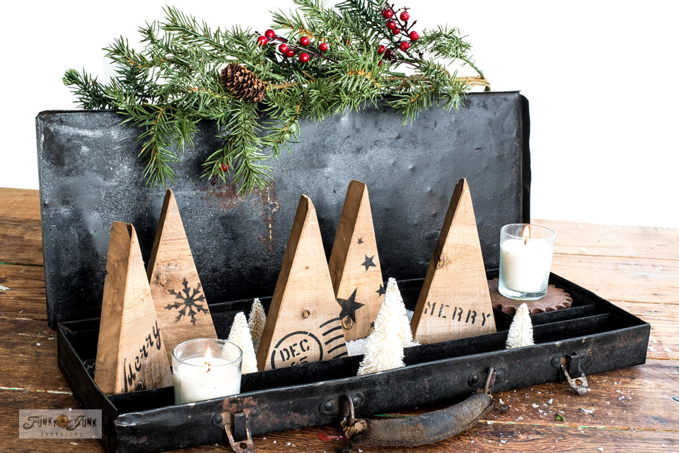 Learn how to make these easy and adorable Stenciled wood scrap Christmas and winter trees! Stencil them with winter patterns and Christmas greetings with Funky Junk's Old Sign Stencils.