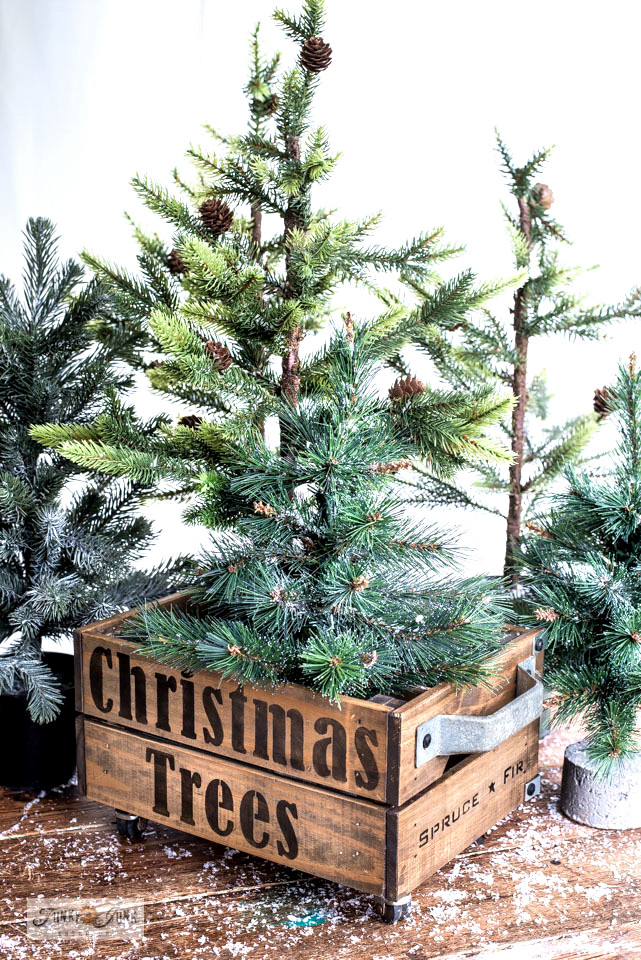 Learn how to create a mini Christmas trees crate forest with an Ikea crate and little faux Christmas trees from Hobby Lobby! Made with Funky Junk's Old Sign Stencils