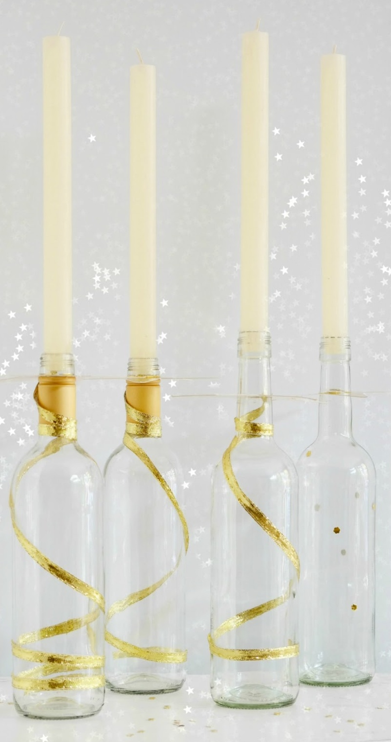 Wine bottle candlesticks by Elsa R Blog, part of a DIY Salvaged Junk Projects 508 feature on Funky Junk Interiors