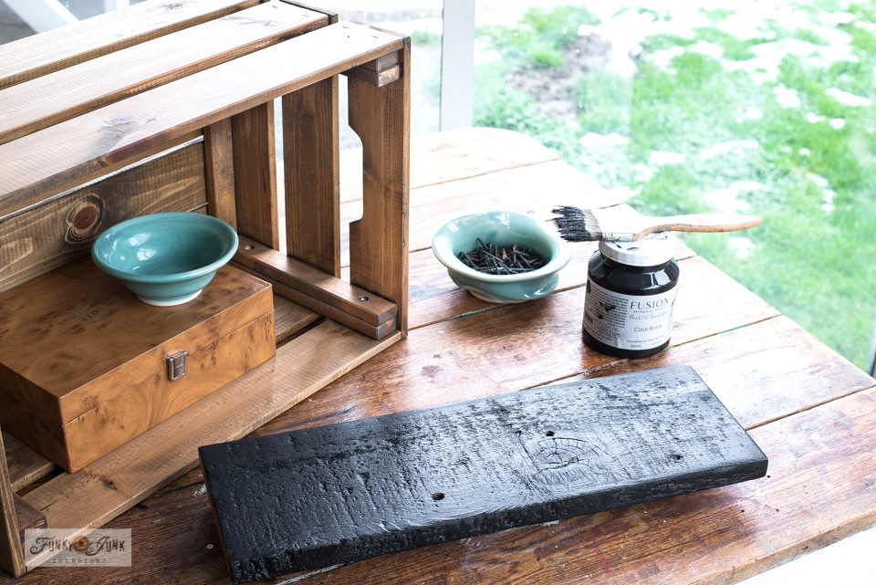 How to add a plank painted in Fusion's Coal Black inside a crate to create a rustic Ikea crate coffee station!