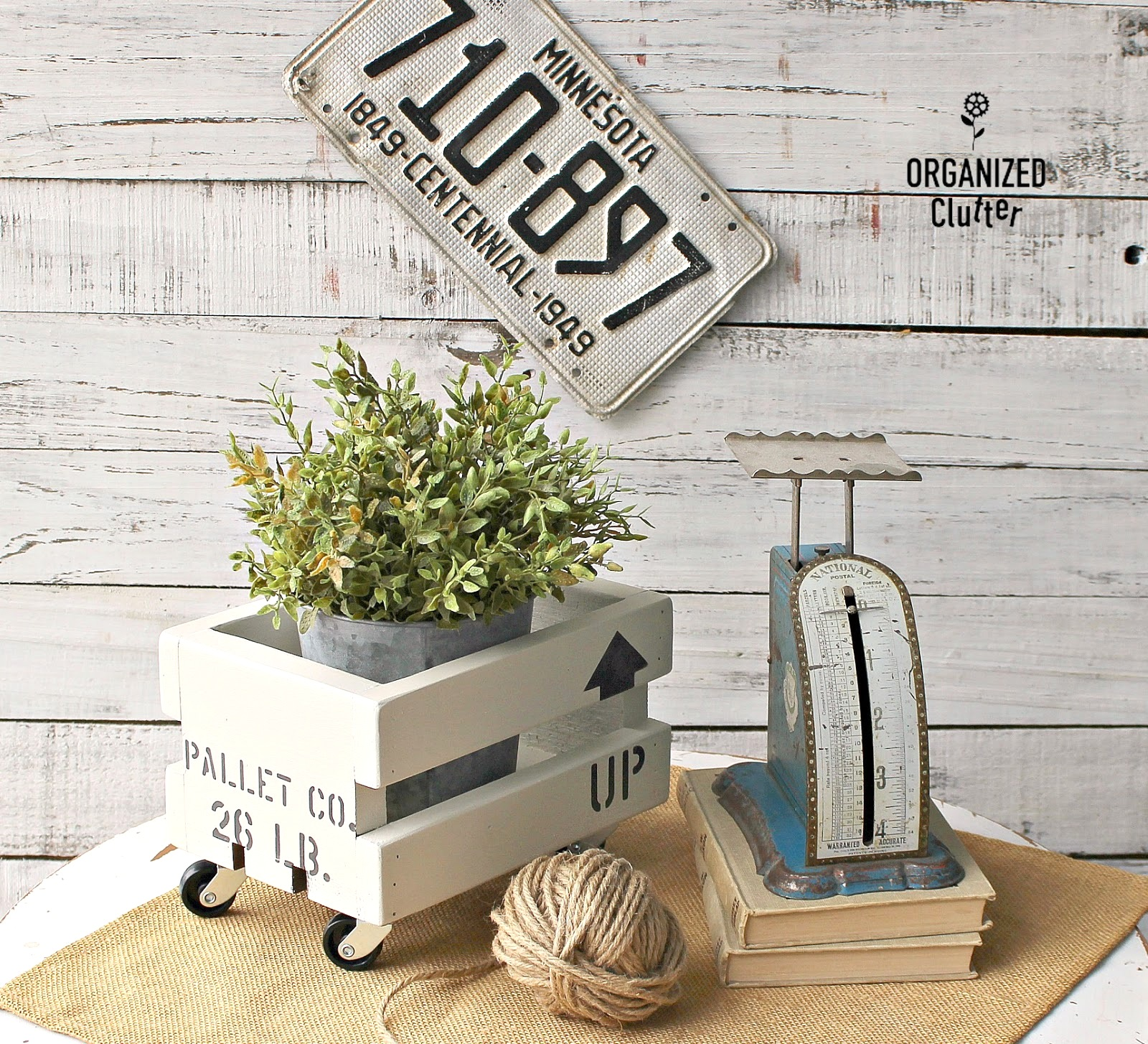 Stenciled shipping crate planter by Organized Clutter, part of a DIY Salvaged Junk Projects 508 feature on Funky Junk Interiors