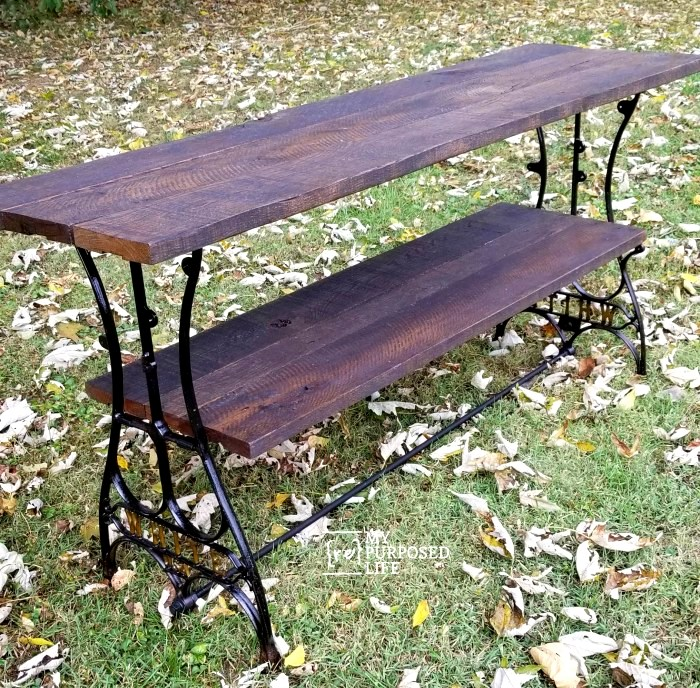 Antique sewing machine TV table by My Repurposed Life, featured on DIY Salvaged Junk Projects 510 on Funky Junk Interiors