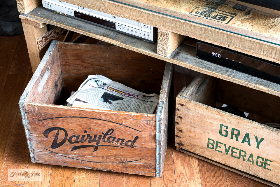 Old vintage crates that use to store movie DVDs now house paper and firewood kindling for the fireplace.