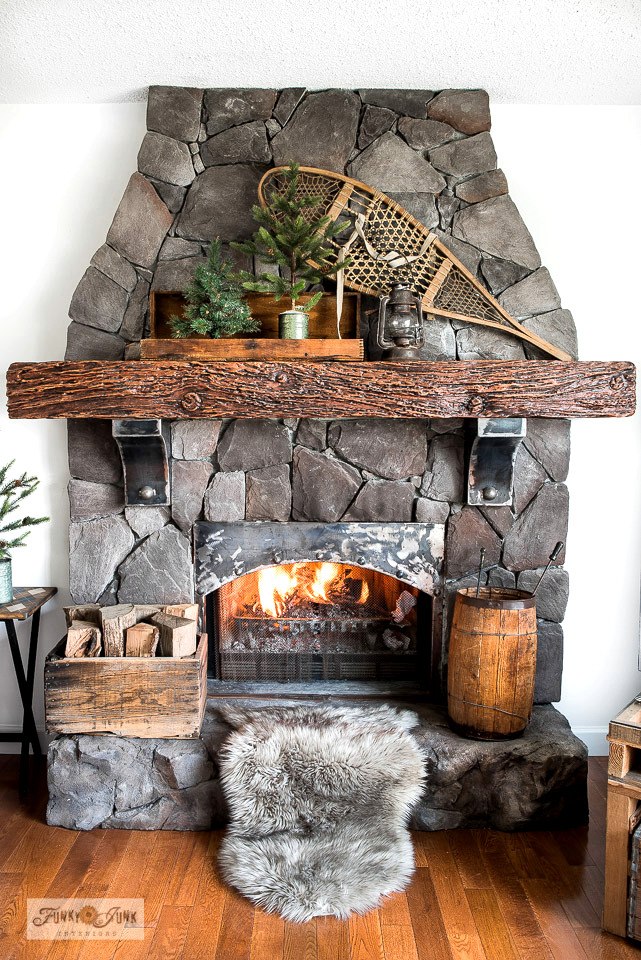 Take the tour of this cozy winter fireplace mantel complete with pine trees and snow shoe. Part of a ski-themed winter living room tour.