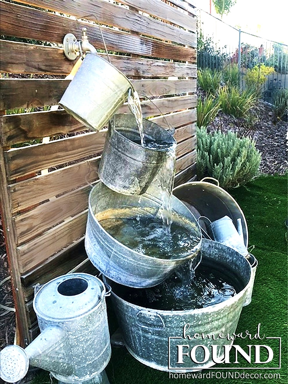 Galvanized buckets water fountain by Homeward Found, featured on DIY Salvaged Junk Projects 516 on Funky Junk Interiors.
