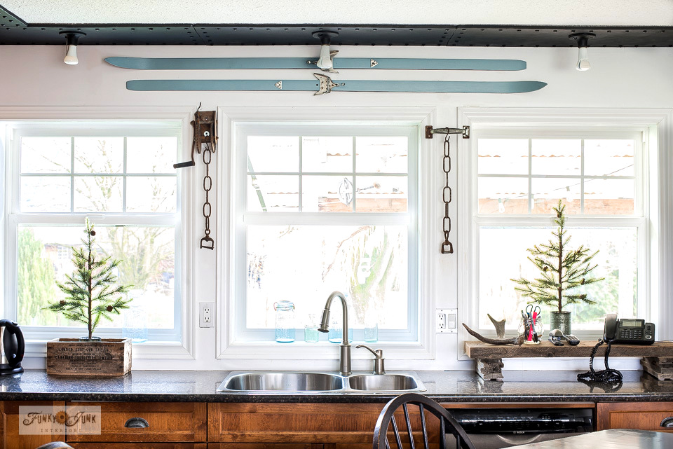 Blue skis painted in Heirloom by Fusion Mineral Paint add winter ambiance to this winter tour of a kitchen! #fusionmineralpaint #furniturepaint #winterdecorating