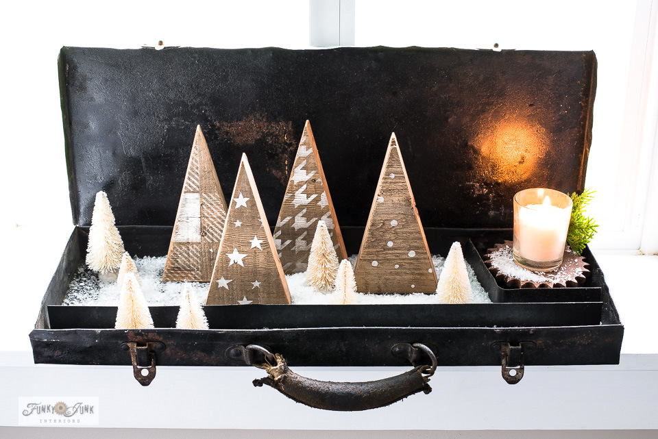 Learn how to make these whimsical scrap wood winter trees tucked inside a toolbox! Part of a ski-themed winter decorating tour. #oldsignstencils #winter #christmas #funkyjunkinteriors