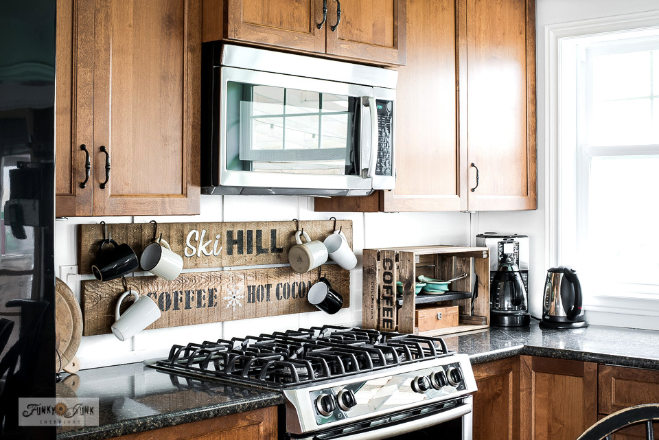 Take a ski-themed winter decorating tour of this rustic kitchen with a Ski Hill coffee and hot cocoa sign stenciled with Funky Junk's Old Sign Stencils. #oldsignstencils #winterdecorating #kitchen