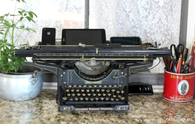 Vintage typewriter phone charging station by Knick of Time, featured on DIY Salvaged Junk Projects 520, at Funky Junk!