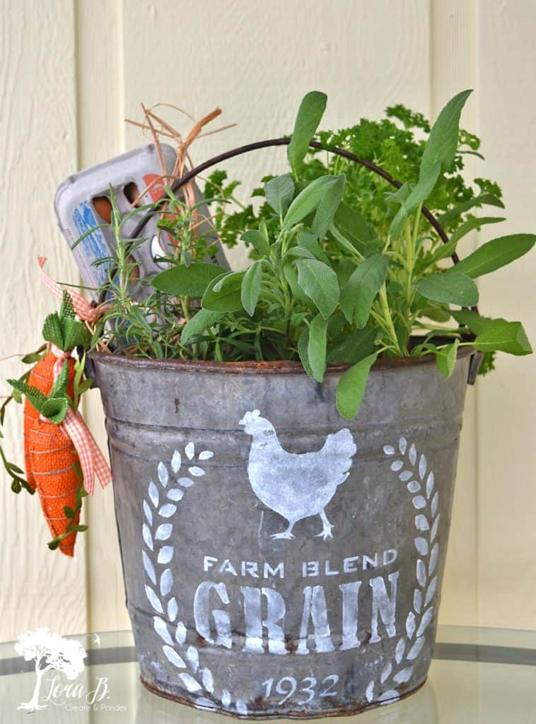 Galvanized farmhouse bucket planter by Lora B, featured on DIY Salvaged Junk Projects 520, at Funky Junk!