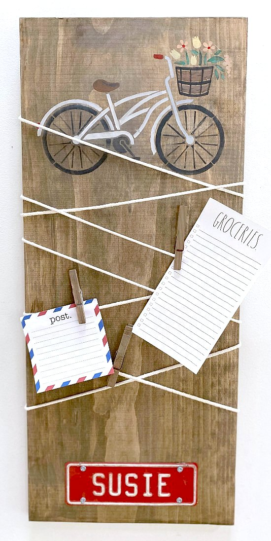 Rustic stenciled bike message centre by Homeroad, featured on DIY Salvaged Junk Projects 520, at Funky Junk!