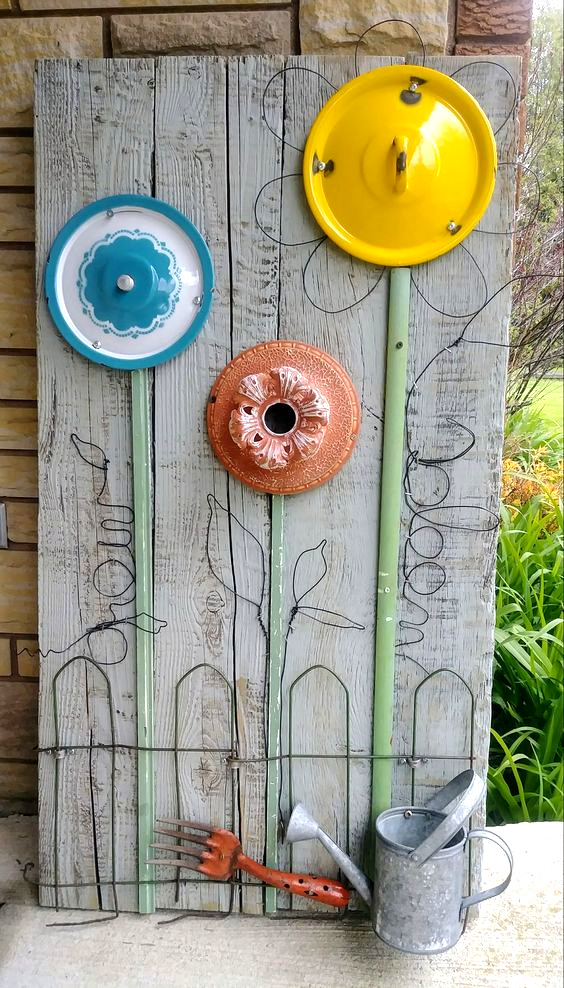 Pot lid junk flower garden by Junky Encores on Facebook, featured on DIY Salvaged Junk Projects 518 on Funky Junk!