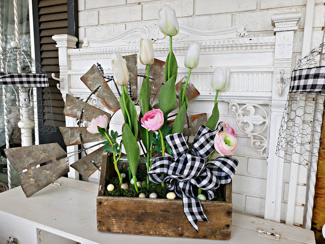 Tulip tool box planter by Penny's Vintage Home, featured on DIY Salvaged Junk Projects 519 on Funky Junk!