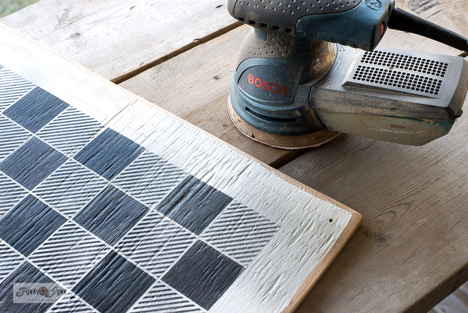 Sanding down edges along a DIY checkerboard - click for full tutorial!