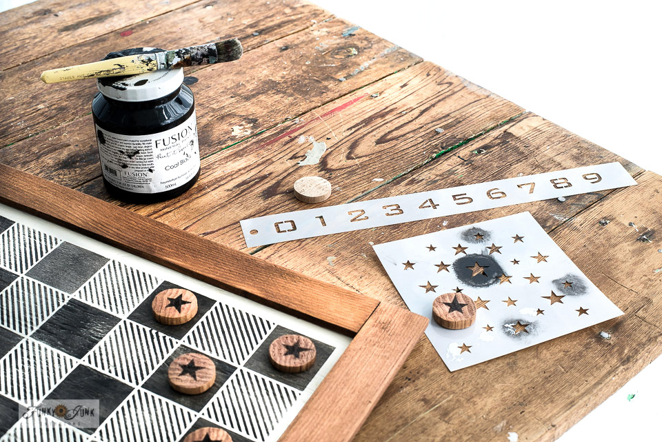 Learn how to make and customize your own DIY checkers with a closet dowel and stencils!