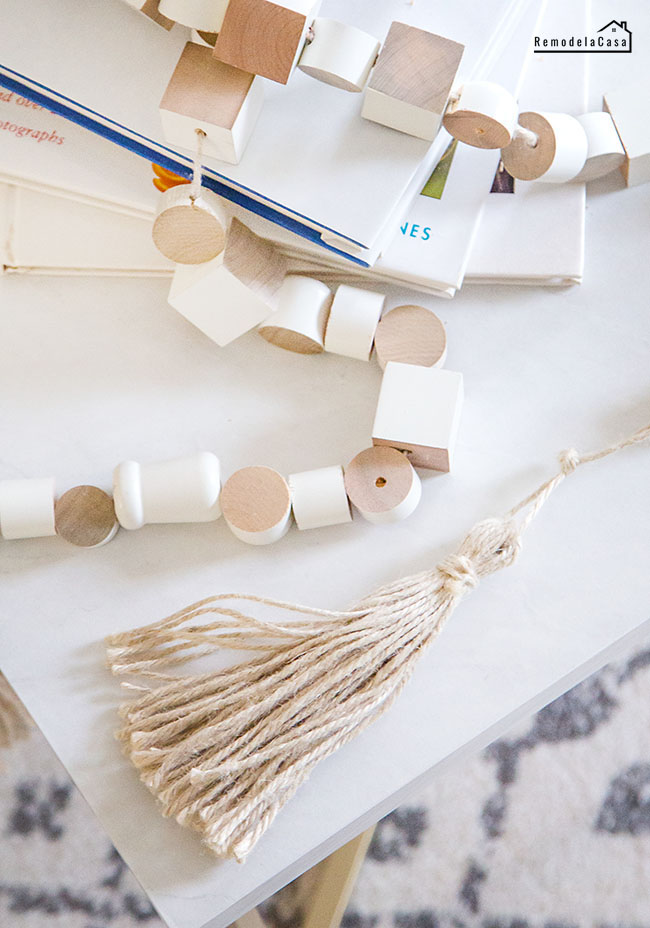 DIY wooden bead garland by RemodelaCasa, featured on DIY Salvaged Junk Projects 524 on Funky Junk!