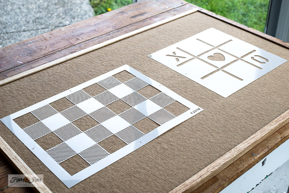 Learn how to turn a plain bulletin board into a super cool puzzle and game board with paint, scrap wood and stencils! #puzzles #checkers #tictactoe #stencils