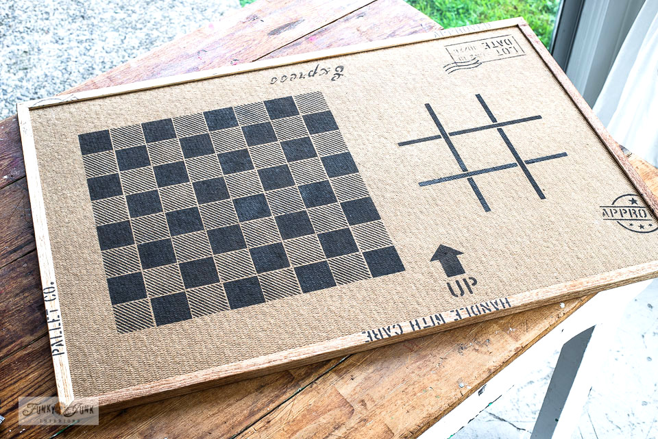 Learn how to make this DIY gameboard of Checkers and Tic Tac Toe on a bulletin board! Plus, it's a puzzle board on the other side! Click for full tutorial including video! #games #checkers #tictactoe #puzzles