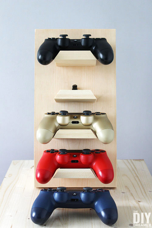 Gaming controller stand by The DIY Dreamer, featured on DIY Salvaged Junk Projects 524 on Funky Junk!