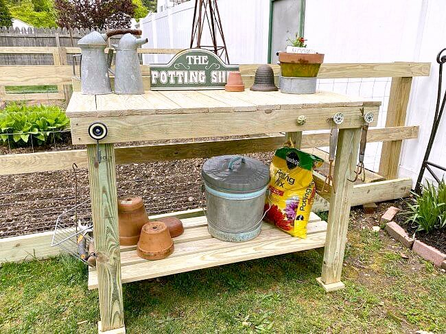 Easy rustic potting or work bench by Homeroad, featured on DIY Salvaged Junk Projects 528 on Funky Junk!