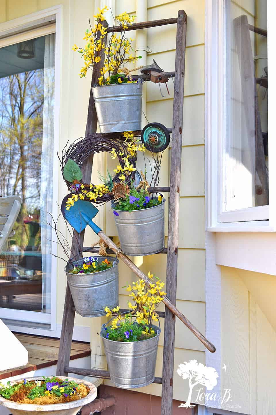 Wooden ladder plant stand by Lora B, featured on DIY Salvaged Junk Projects 526 on Funky Junk!