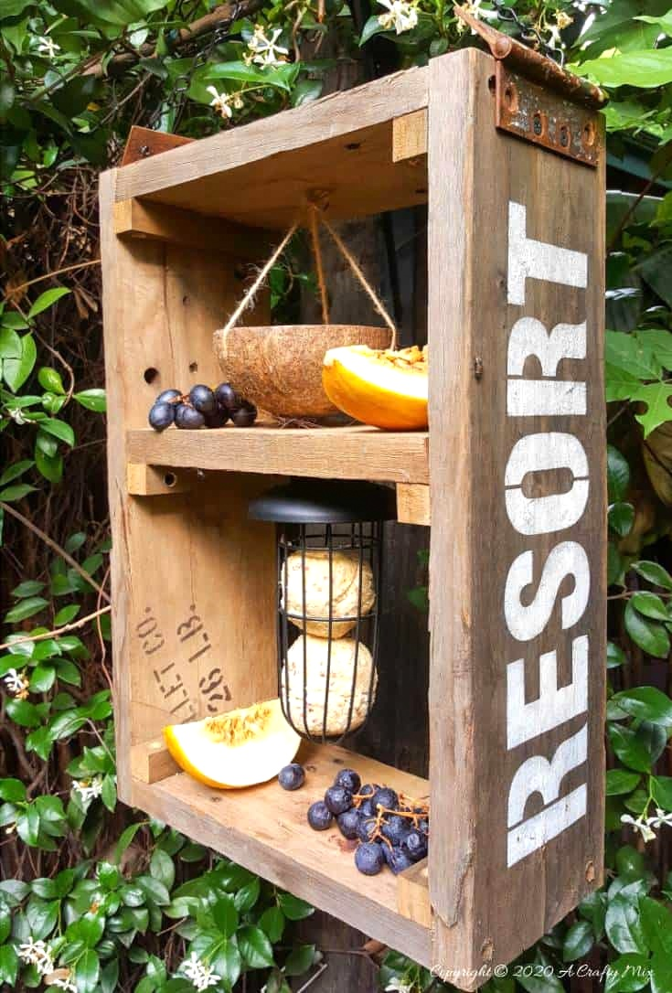 Reclaimed wood bird resort feeder by A Crafty Mix, featured on DIY Salvaged Junk Projects 528 on Funky Junk!